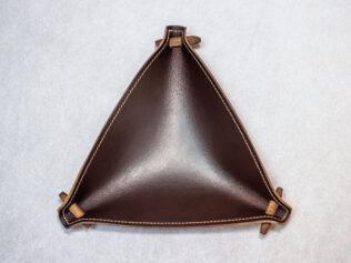 Vacíabolsillos triangular
